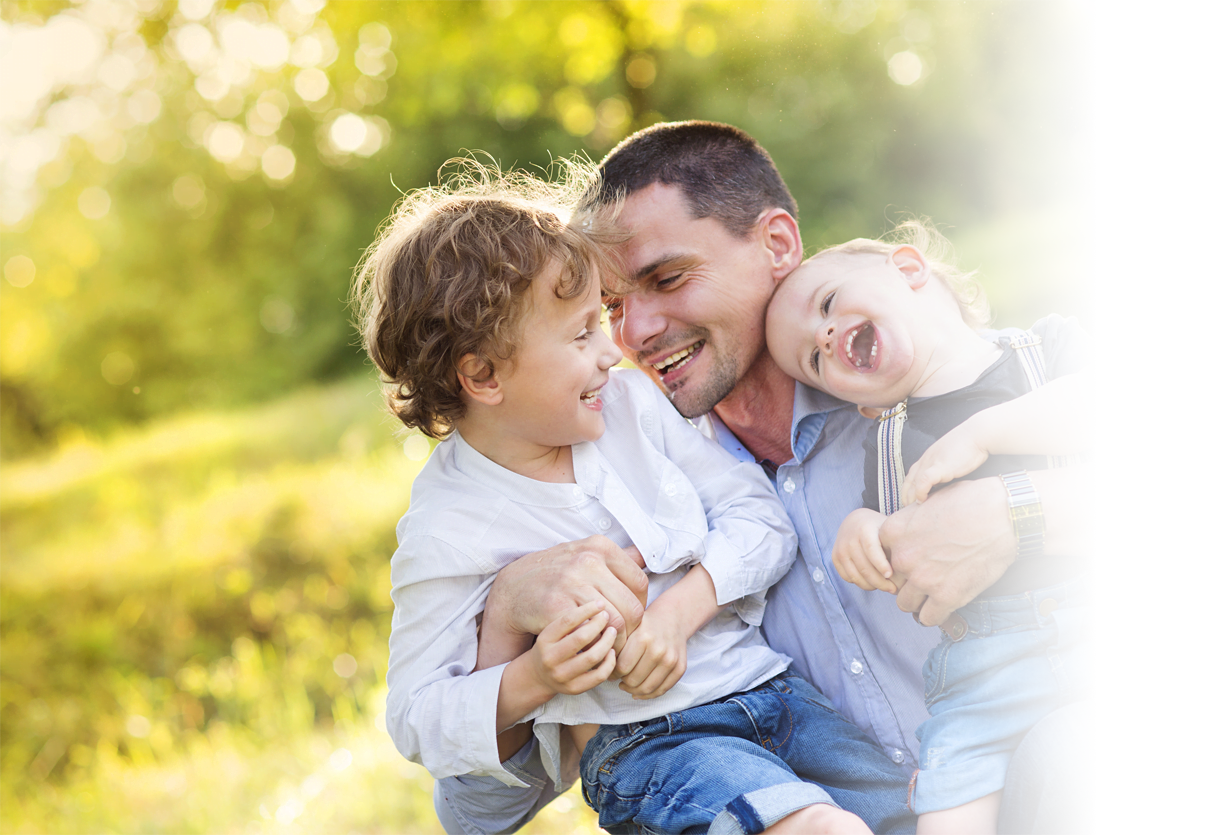 Man with his children following Family Law Custody Agreement